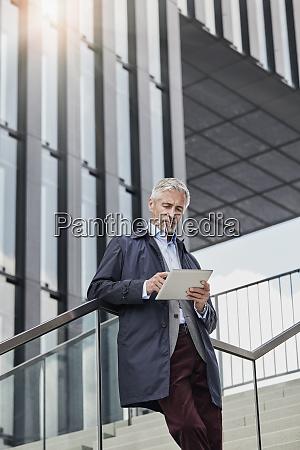 portrait of mature businessman standing on