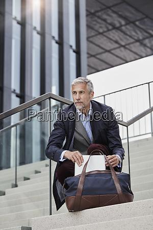 portrait of mature businessman with traveeling