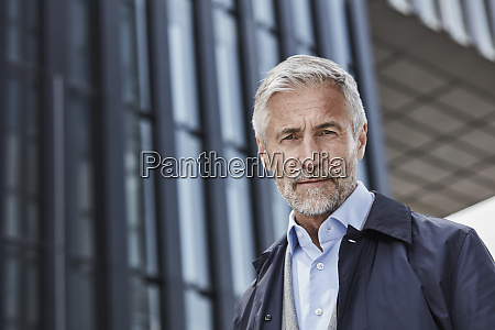 portrait of mature businessman in front