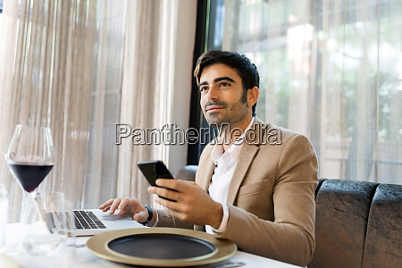smiling man sitting at table in