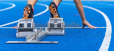 detail of female runner in starting