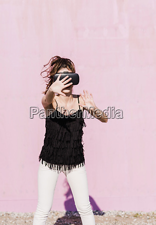 young woman wearing vr glasses in