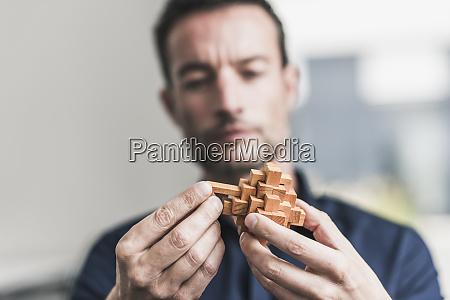 mature man sitting in office assembling