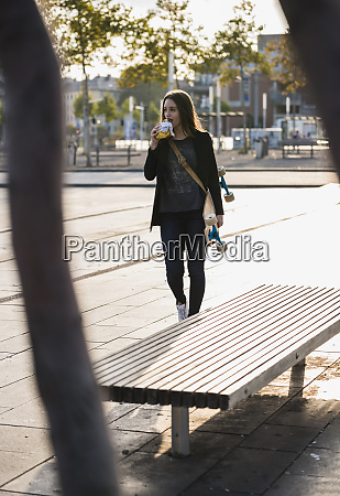 young woman with longboard having a