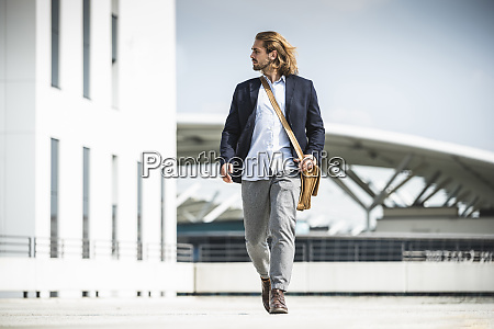 young businessman walking in the city