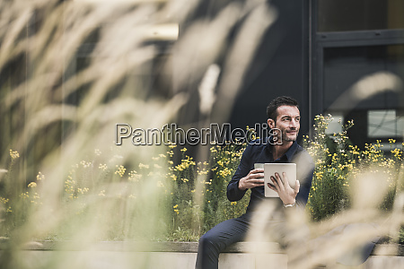 businessman sitting outside taking a break