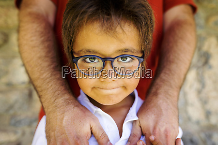 portrait of little boy wearing glasses