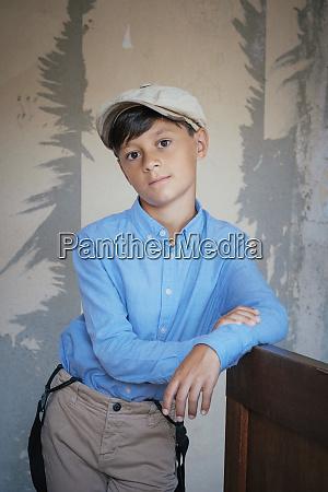 portrait confident well dressed boy
