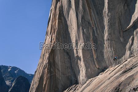 distant view of adventurous man swinging