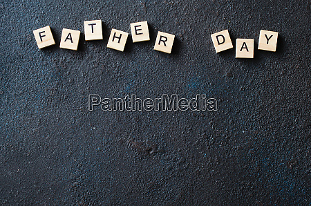 fathers day concept wooden letters on