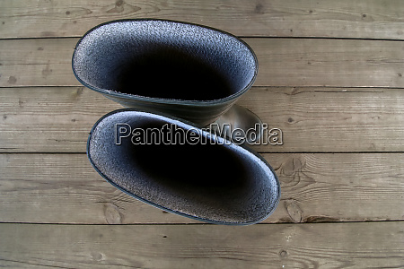 rubber boots on the wooden floor