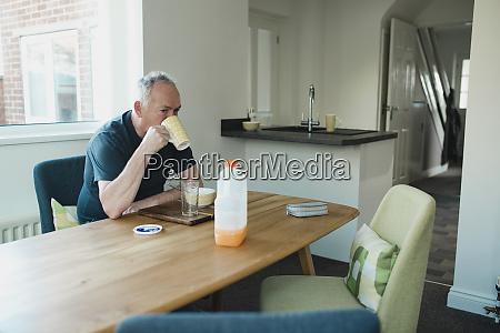 retired man enjoying breakfast