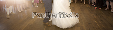 panorama of bride and groom dancing