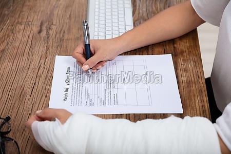 injured woman filling work injury claim