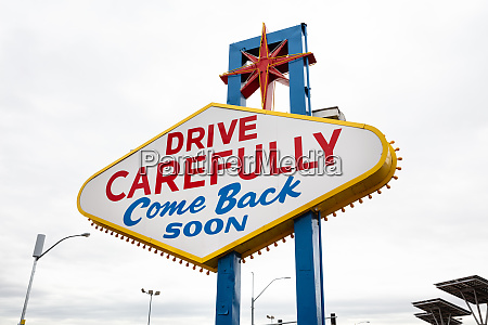 drive carefully come back sign while