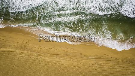 green ocean on yellow sand
