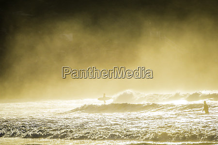 sea mist morning surf at sunrise