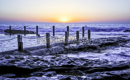 ocean pool at sunrise over the