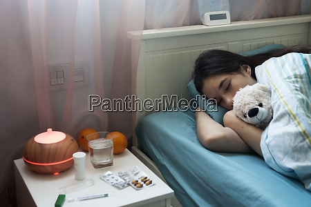 teenage girl in bed at home