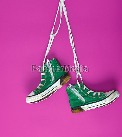 pair of green textile sneakers on