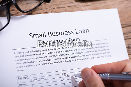businessperson filling small business loan application