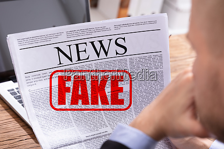 man reading fake news