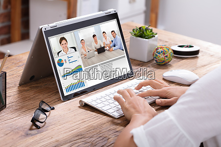 businesswoman video conferencing with his colleagues