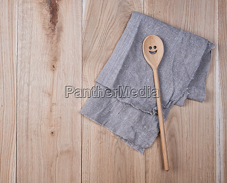 folded gray towel and spoon