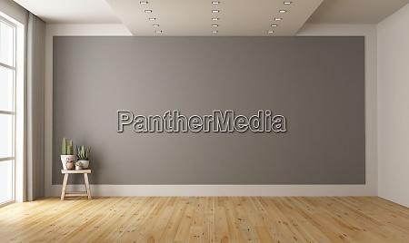 empty minimalist room with gray wall