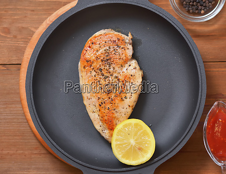 fried chicken breast with half a