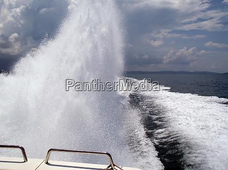 powerful boat splashing water