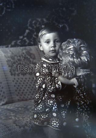 vintage photo of little girl holding