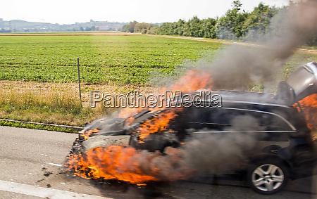 burning car at the roadside