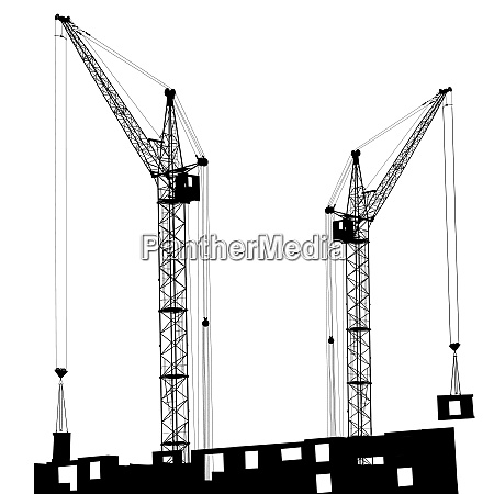 silhouette of two cranes working on