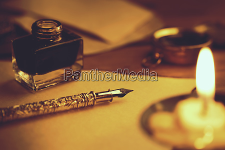 retro quill pen and inkwell on