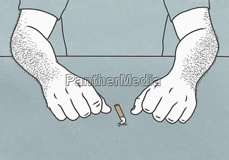 midsection of man behind cigarette butt