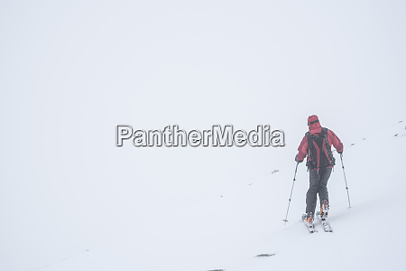 ski touring in a snow blizzard