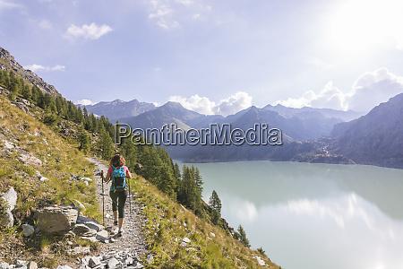 hiker on path towards rifugio bignami