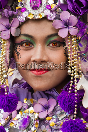 indonesian woman in carnival costume celebrating