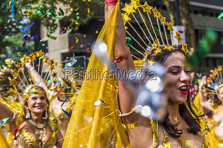 a colourfully dressed participant in the