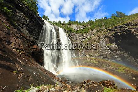 beautiful waterfall and rainbow in norway