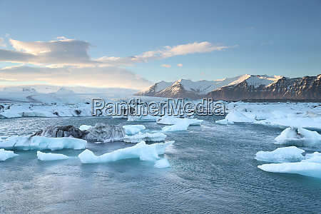 icelandic glacier jokulsarlon with icebergs floating