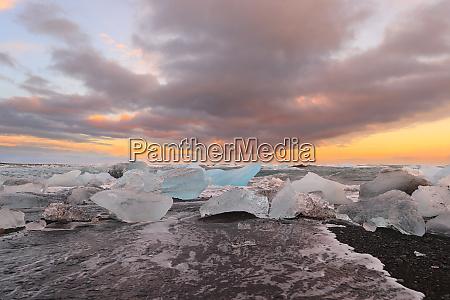 icelandic glacier jokulsarlon with icebergs on