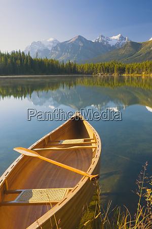 canoe on herbert lake at sunrise