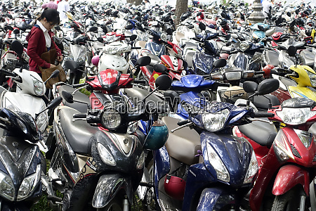 scooters and motor cycles in a