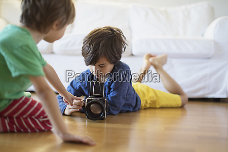 two brothers at home exploring an