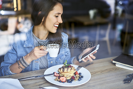 smiling young woman with plate of