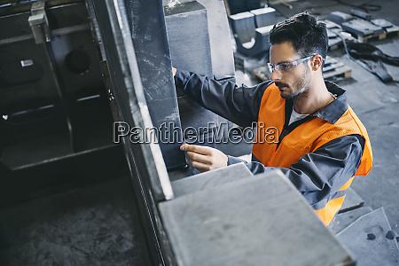 man wearing protective workwear working in
