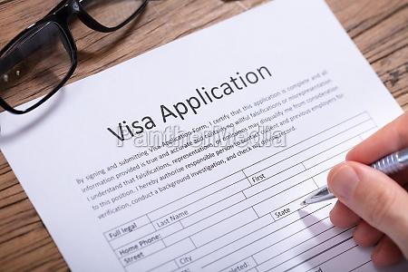 man filling visa application form