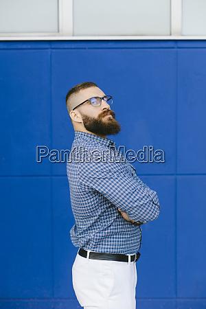 portrait of bearded hipster businessman wearing